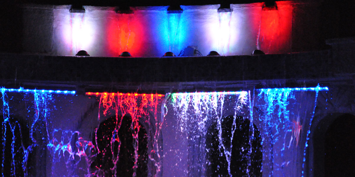 Waterfalls at night in the heated outdoor pool