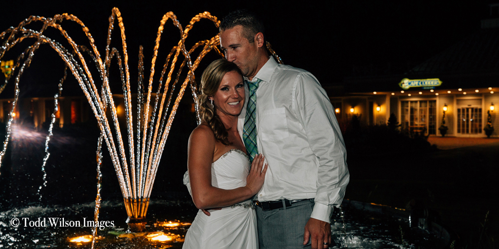A couple by the fountain at the Cape Codder Resort and Spa