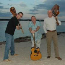 After more than a decade apart, the three original members of the 1990s band Hazy, Hot & Humid reunited and have been playing six nights a week on the Cape for the past few years. Pictured after reuniting in 2010 they are, from left to right, Bill Rountree, Randy Hebditch and Steve Hanlon. Photo by Kathy Hanlon